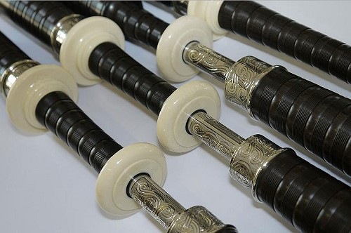 D. Naill 2E Bagpipes With Reposse Engraving Imitation Ivory Mounts, Nickel Ferrules, Drone Slides, and Ring Caps